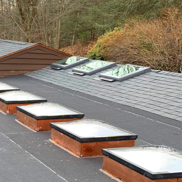 Skylight installation with copper flashing on a low-sloped asphalt roof in Pleasantville, NY
