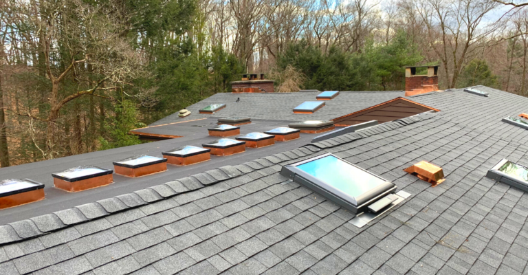 New medium gray asphalt roof shingles on a low-sloped roof in Westchester County, NY