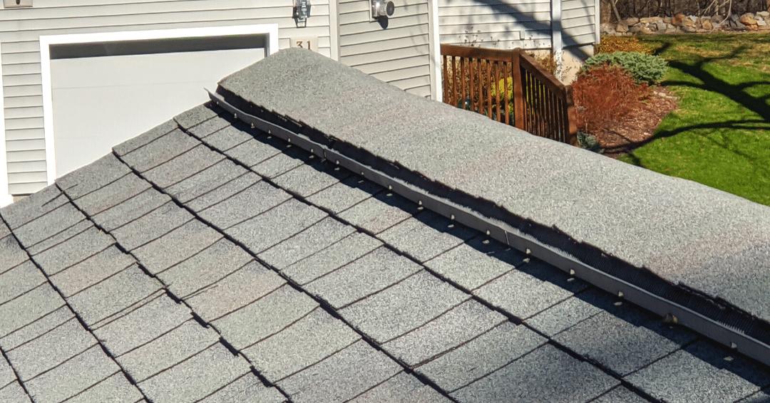 Ridge vents on a dark gray roof in Ossining, NY